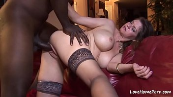 Interracial banging for a busty babe in stockings