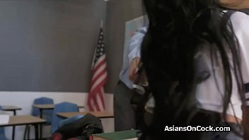 Big dick threesome with Asian coeds in the classroom