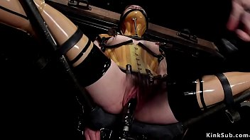 Spreaded legs in metal device bondage brunette slave Juliette March in yellow plastic corset and rubber stockings gets fast machine and whip