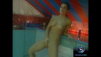 Lora Craft gets naked flaunting her tight body and delicious privates