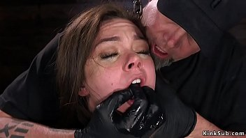 Shackled brunette anal fucked with dildo