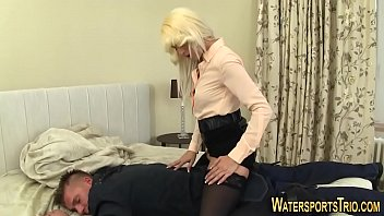Clothed babe gets peed on
