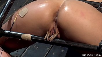 Busty slave is vibed in backbend device