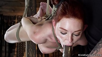 Gagged redhead whipped and fingered