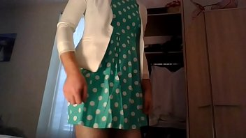 Amateur cross dresser in a cute polkadots dress and a sexy white blazer home after work