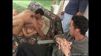 A sexy milf is getting fucked in front of two guys