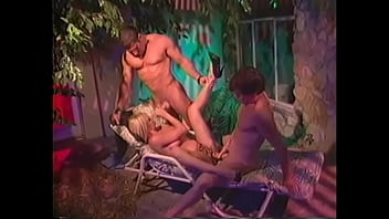 Marvelous busty blonde gets DP action from two big dicks on pool bed