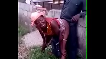 African woman fucks her man in public