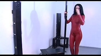 Girl in red latex tied up tries to get out