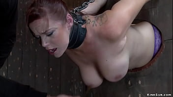 Bound busty slave in extreme position