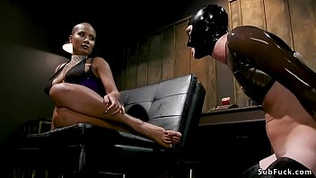Shaved head ebony torments male slave