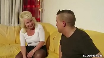 Aunt Claudi helps him with the first fuck with her pussy