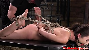 Spreadeagled bondage sub toyed using vibrator