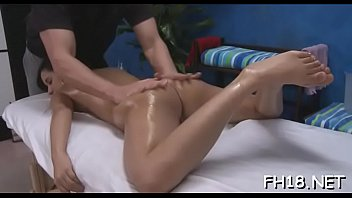Girl spreads legs wide and starts pushing dildo in her cunt