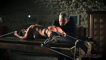 Teen sex slave is tied up and fucked while getting spanking and slapping صورة