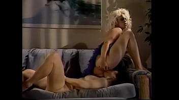 Hot blonde licks lusty brunette's pussy on the sofa