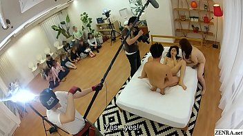 Behind the scenes JAV filming featuring a huge group of real married women watching as one of their own joins the fun with legendary MILF Chisato Shouda helping out as a naked third wheel in HD