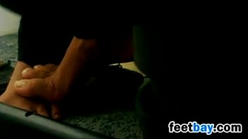 Exposed Feet And Toes Under The Chair
