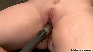 Busty sub chained in back arch position