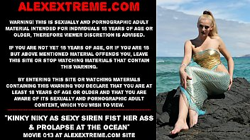 Kinky Niky as sexy siren fist her ass & prolapse at the ocean