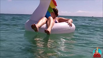 my husband, my unicorn and me in erotic play on a public beach.
