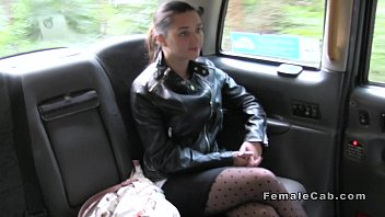 Female taxi driver licks brunette outdoor