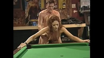 Pretty redhaired chick in black leather dress Chloe was able to cop off with two well stuffed dudes in bikers road house