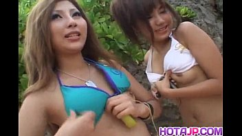 Shiho Kano and dolls play with vibrators on pussies on the beach