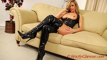 Glamourous Mistress Melanie Shows Her Stunning Beauty As She Taunts Her Slave With A Wet Look Rubber Corset And Knee High Boots Gently Bending Over Showing Her Tight Gstring Butt Crack In Your Face