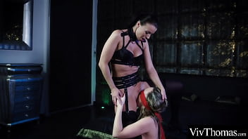 Hot brunette  blindfolds sexy blonde and grinds her wet pussy on her submissive's mouth