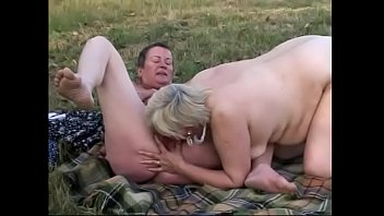 Whore granny eats her lover's pussy in the grass