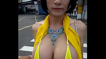 Woman records her beautiful breasts in the middle of the street