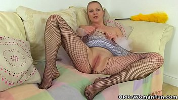 English milf Abi gets busy in fishnet tights