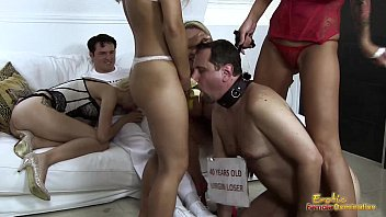 Mistresses-Feed-Banana-To-Cuckold-Frank-For-Blowjob-Lesson