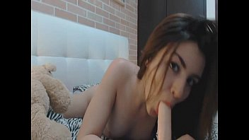 Beautiful girl blowing her dildo