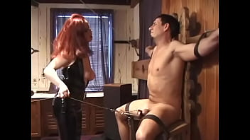 Redheaded mistress Nya pulls weights attached to bondaged dude's balls