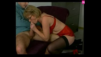 Mature Secretary Pleases in Red Satin & Stockings