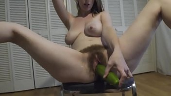 Hairy amateur from 69webcam.net toying with cucumber