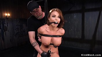 Busty oiled beauty pussy vibed in bondage