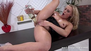 Blonde MILF takes on huge dildo