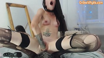 Naughty fisting by beautiful young brunette in stockings and tattoos