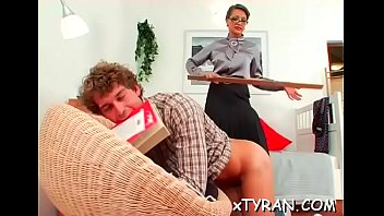 Slave licks mistress' feet and gets whipped hard in sexy sadomasochism