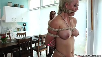 Busty lezdom whips tied babe in kitchen