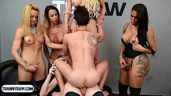 Guy gets gangbanged by five latin tranny pornstars