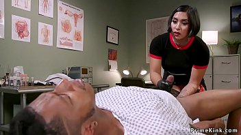 Busty brunette Asian doctor fingering her black patients ass and massages his prostate