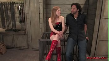 Blonde mistress plays with her black slave