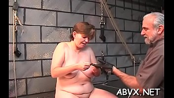 Prodigious chick slowly getting naked to turn him on