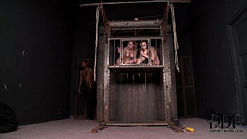 Two Hot Blonde Babes Caged, Flogged & Forced To Suck & Fuck