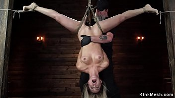 Blonde in upside down bondage position