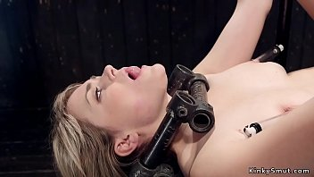Busty blonde is caned in bondage